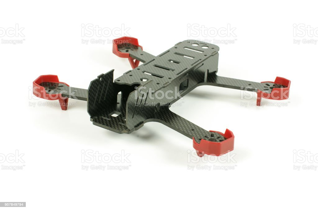 Carbon fiber racing drone frame isolated on the white background stock photo
