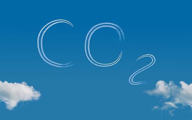 carbon footprint - schrift am himmel stock-fotos und bilder