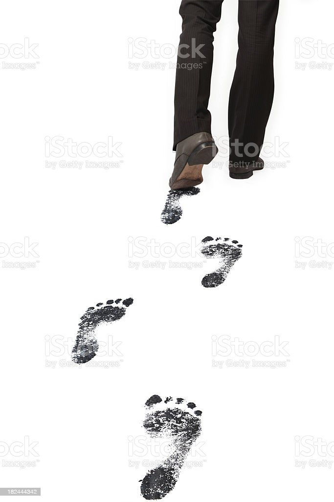 Carbon Footprints after businessman - isolated XXL royalty-free stock photo