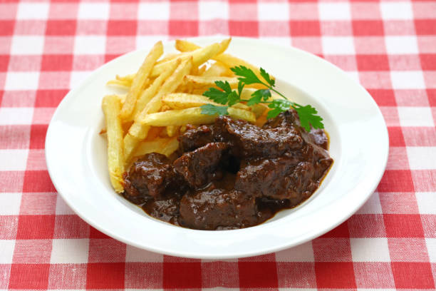 carbonade flamande, flemish beef stew, belgian cuisine carbonade flamande with frites , flemish beef stew, belgian cuisine benelux stock pictures, royalty-free photos & images