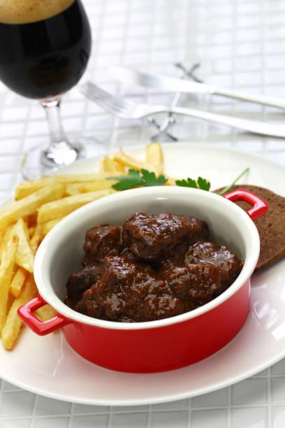carbonade flamande, flemish stew, belgian cuisine carbonade flamande with frites , flemish beef stew, belgian cuisine benelux stock pictures, royalty-free photos & images