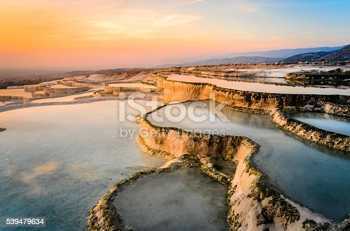 istock Carbonate travertines the natural pools during sunset, Pamukkale 539479634
