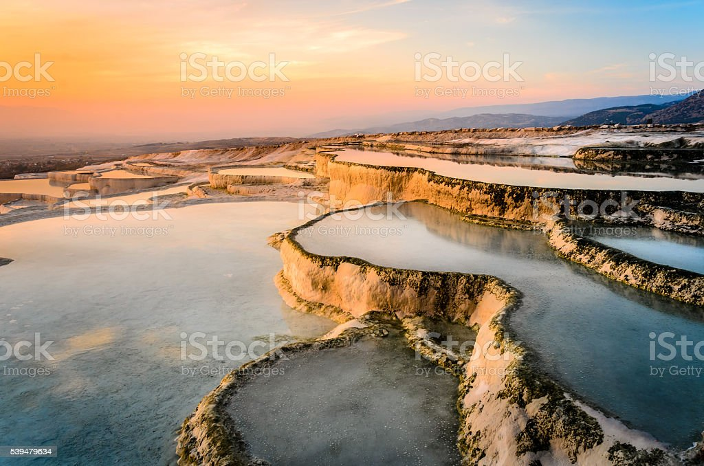 Carbonate travertines the natural pools during sunset, Pamukkale stock photo