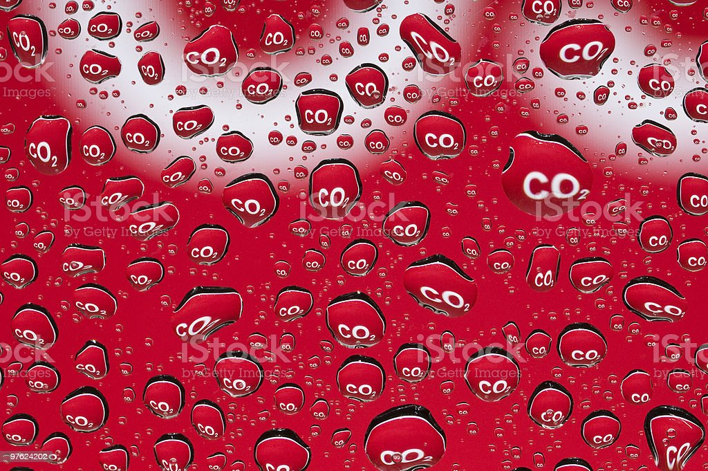 Carbondioxide symbol reflected in numerous water droplets depicting combustion emission royalty-free stock photo