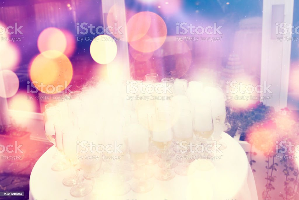 Carbonic ice champagne glasses party background stock photo