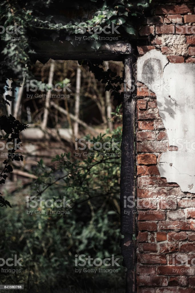 Carbonized door post in wall of abandoned building. stock photo