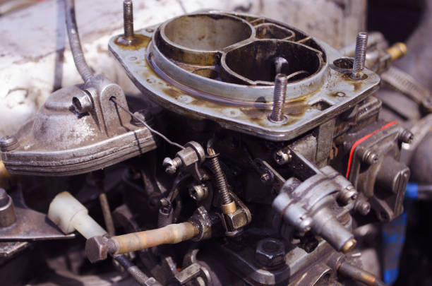 Carburetor of the internal combustion engine of a VAZ 2106. Automobile parts and spare parts. Carburetor of the internal combustion engine of a VAZ 2106. Automobile parts and spare parts. carburetor stock pictures, royalty-free photos & images