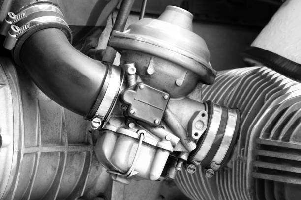 Carburetor on the engine of the vintage motorcycle stock photo