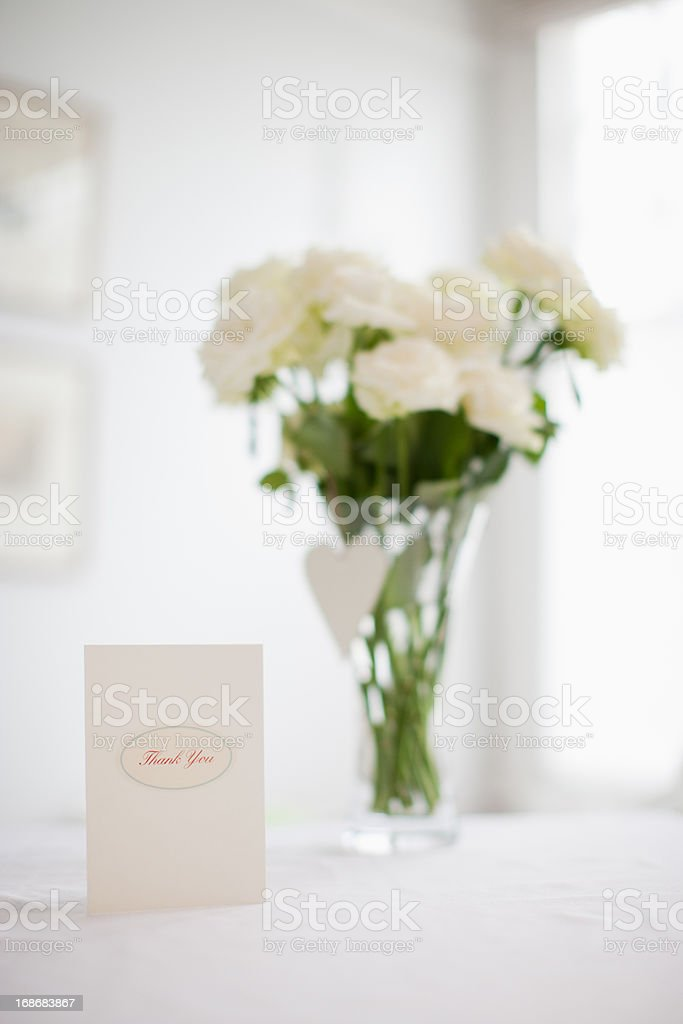 Card and bouquet of white roses royalty-free stock photo