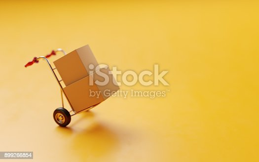 istock Card boxes On A Hand Truck On Yellow Background 899266854