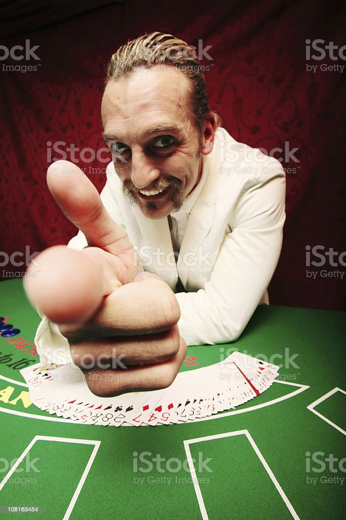 Card Dealer Giving Hand Gesture and Pointing royalty-free stock photo