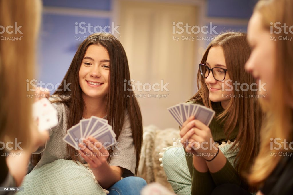 card game teens stock photo