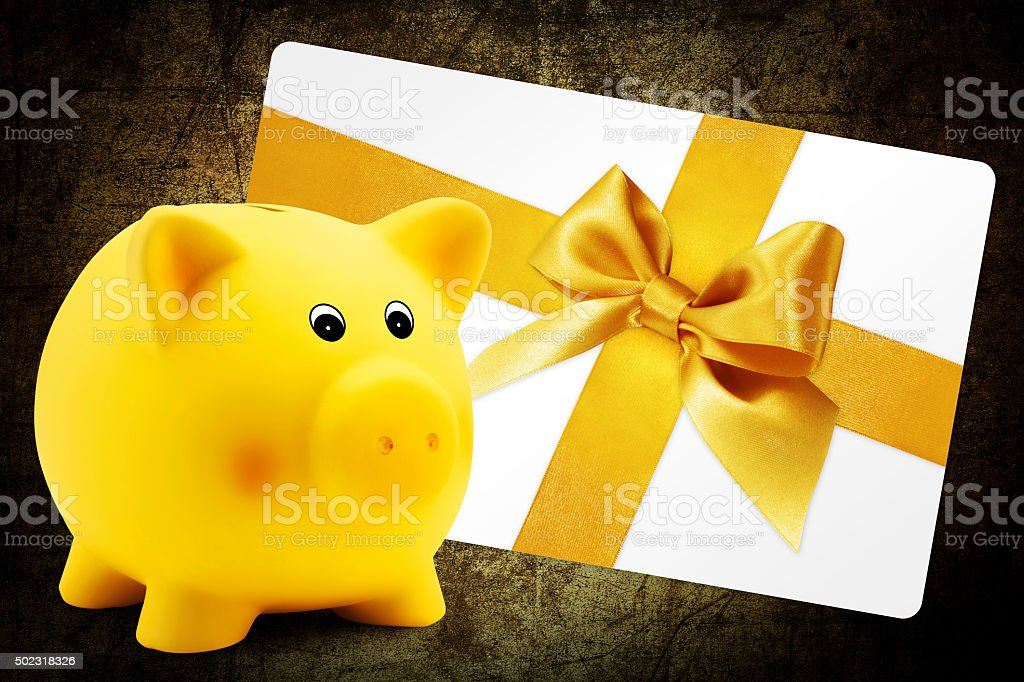card gift with piggy bank, golden ribbon bow, Isolated stock photo