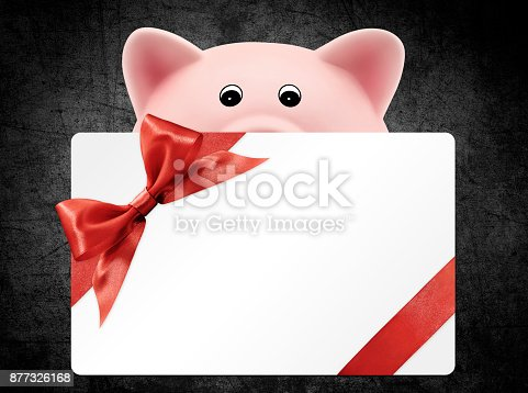 670414478 istock photo card gift with piggy bank, red ribbon bow, Isolated on black background 877326168