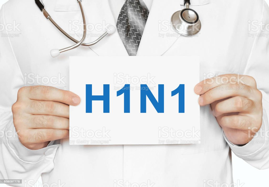 H1N1 card in hands of Medical Doctor stock photo