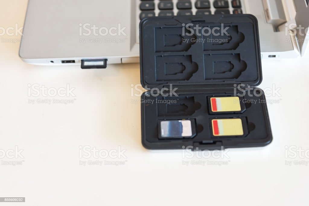 SD card inserted into laptop slot stock photo