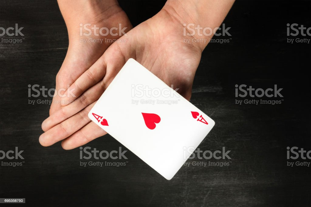 Card levitating above girls hands with copyspace stock photo