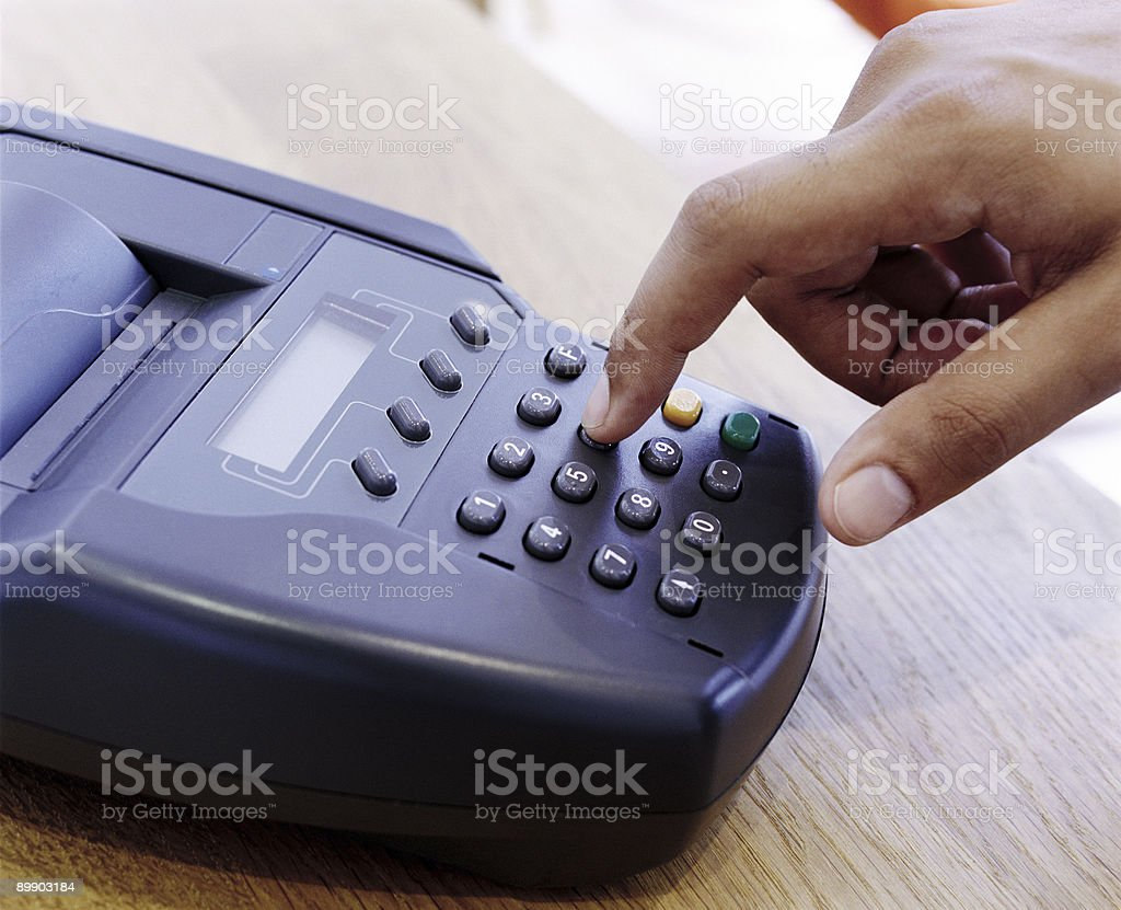 Card machine and hand royalty-free stock photo
