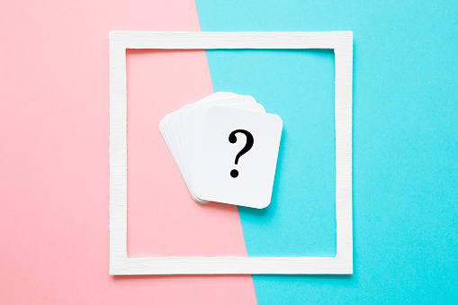 istock Card of question mark in white frame on pastel pink and turquoise blue background. Soft light color. Teenagers issues. Boys and girls problems and solutions concept. 1026437606