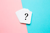 istock Card of question mark on pastel pink and turquoise blue background. Soft light color. Teenagers issues. Boys and girls or men and women problems and solutions concept. Couples relationships. 1049204390