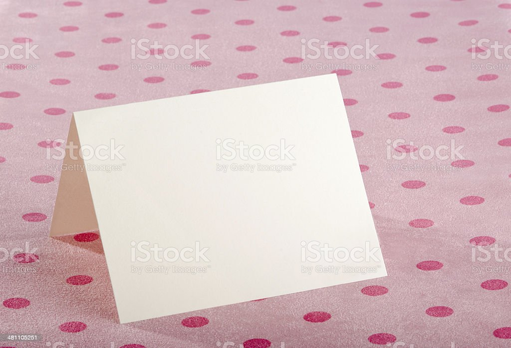 Card on a Pink Polka Dot Tablecloth royalty-free stock photo