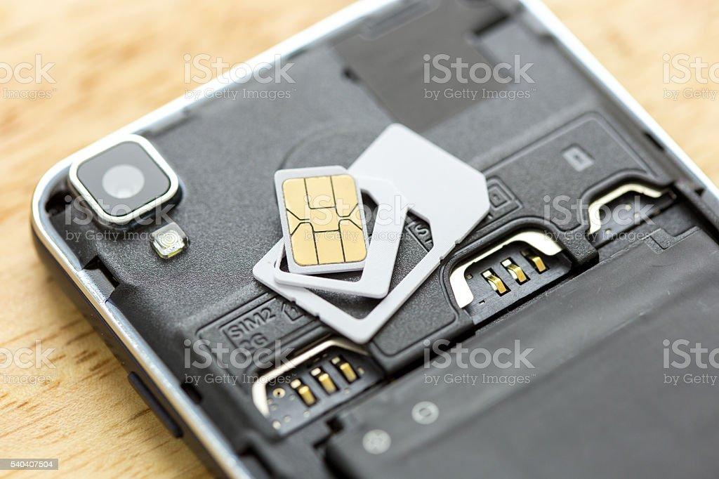 SIM card on the smart phone stock photo