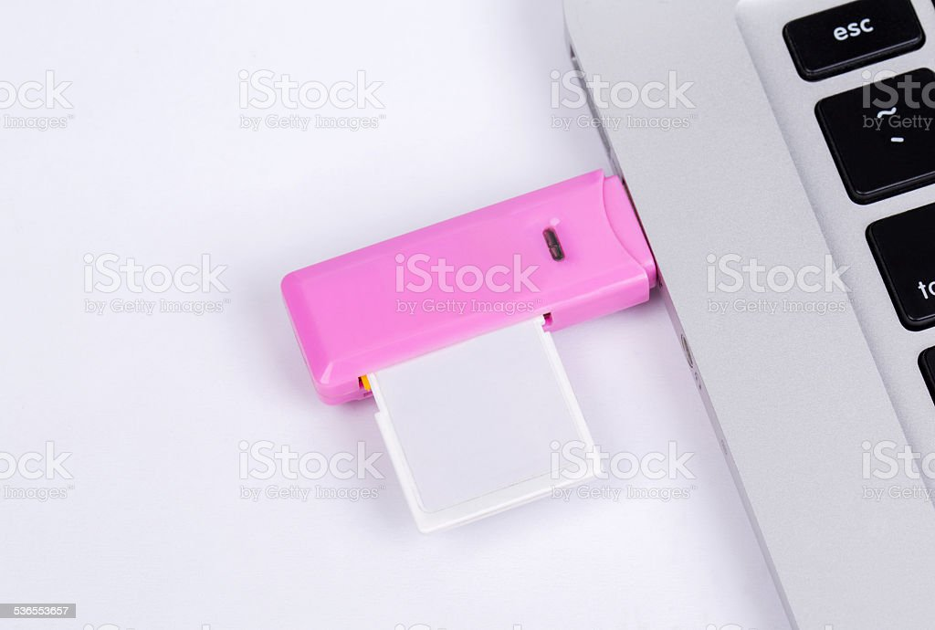 SD card plugging on a laptop stock photo