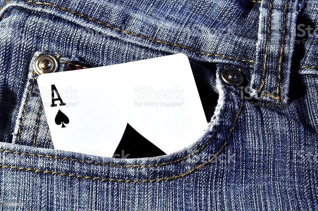 Card sticking out of pocket in jeans stock photo