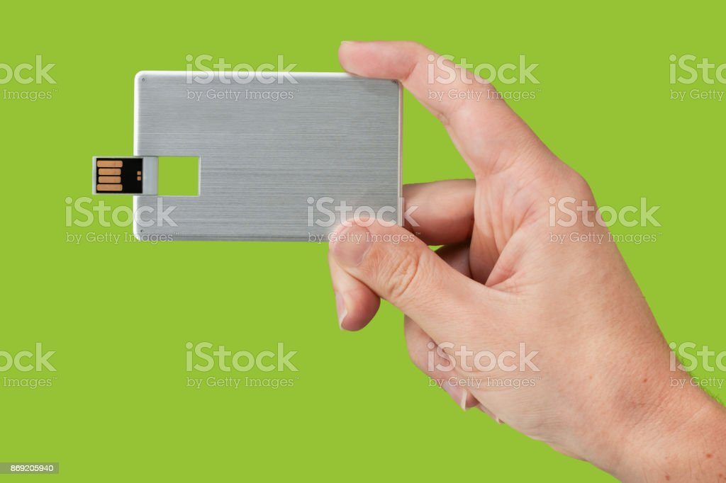 Card USB flash memory on hand with isolated green background