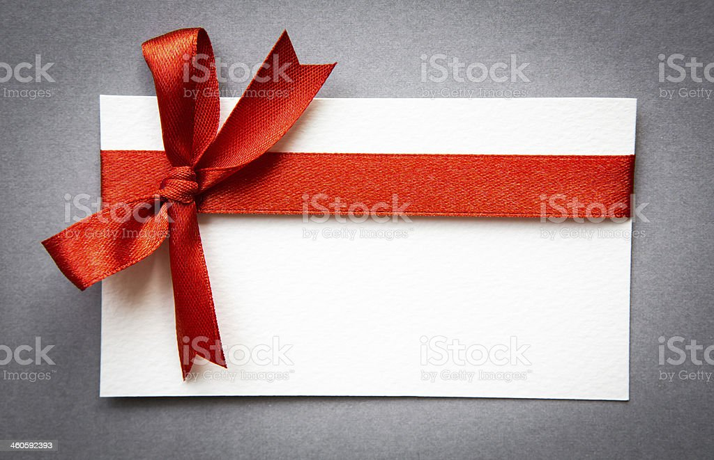 Card with red ribbons bows stock photo