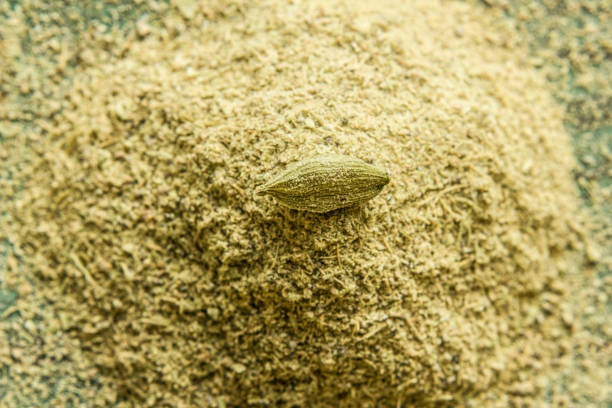 Cardamom pods and cardamom powder, close-up Cardamom pods and cardamom powder, close-up cardamom stock pictures, royalty-free photos & images