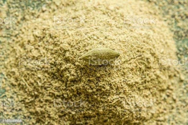 Cardamom Pods And Cardamom Powder Closeup Stock Photo - Download Image Now