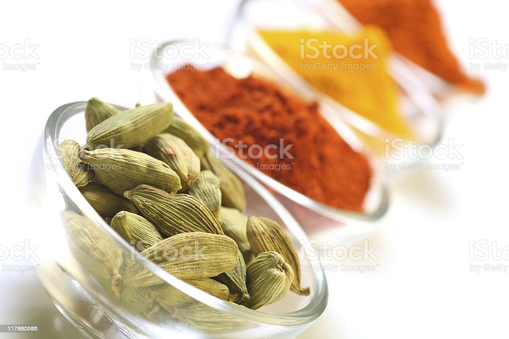 cardamom seedpods and spices stock photo