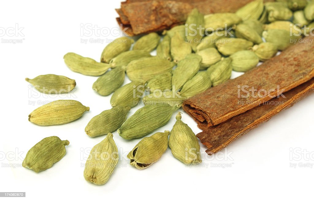 Cardamom seeds with cinnamon barks royalty-free stock photo