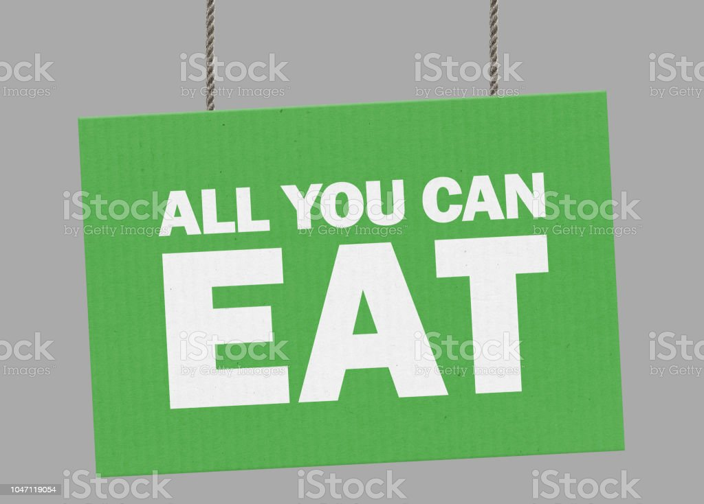 Cardboard all you can eat sign hanging from ropes. Clipping path included so you can put your own background. stock photo