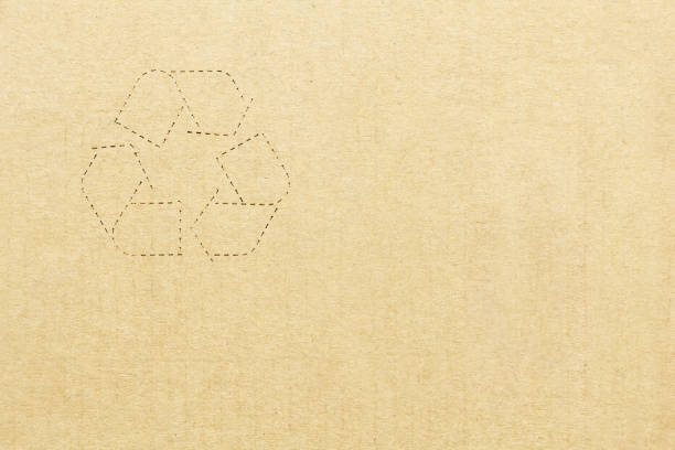 Cтоковое фото Cardboard box background with recycle symbol