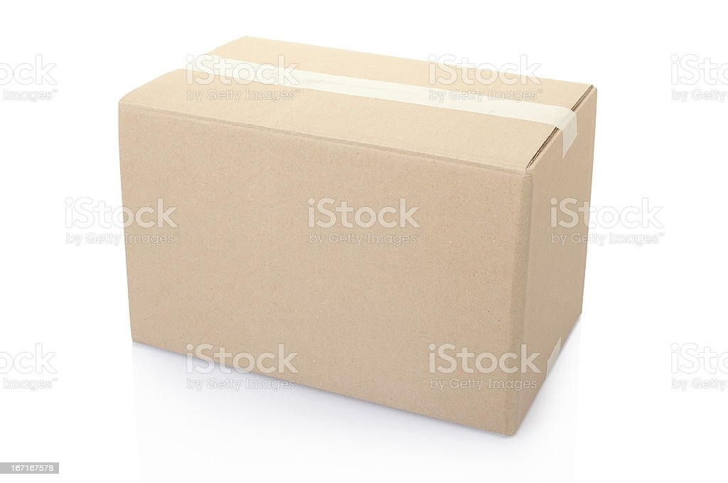 Cardboard box closed with tape stock photo