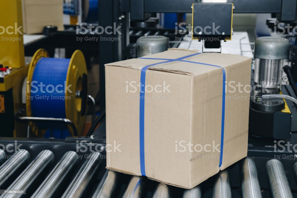 cardboard box of product packaging is moving on conveyor belt of...
