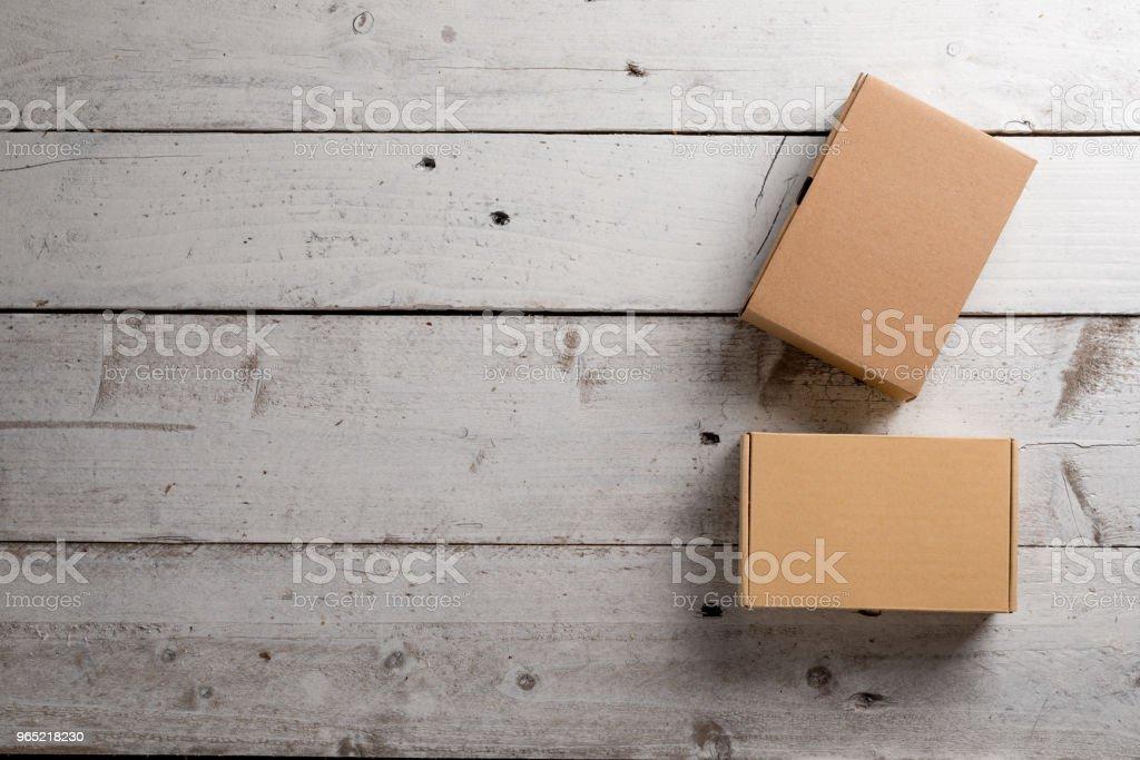 Cardboard box on a wooden background zbiór zdjęć royalty-free