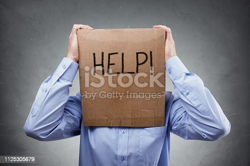 istock Cardboard box on businessman head ask for help 1125305679