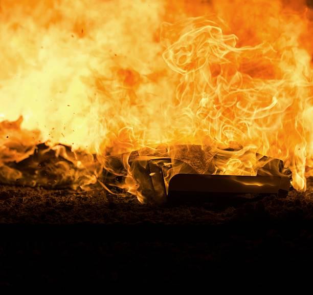 cardboard box on fire stock photo