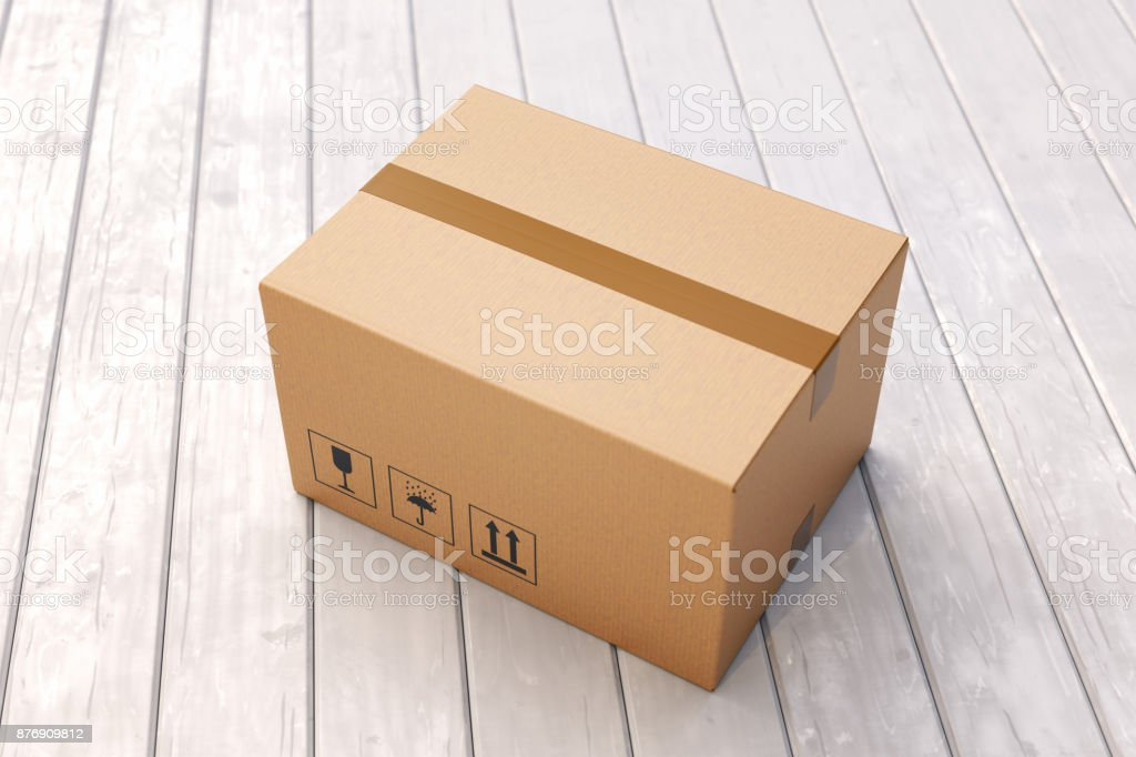 Cardboard box on porch floor stock photo