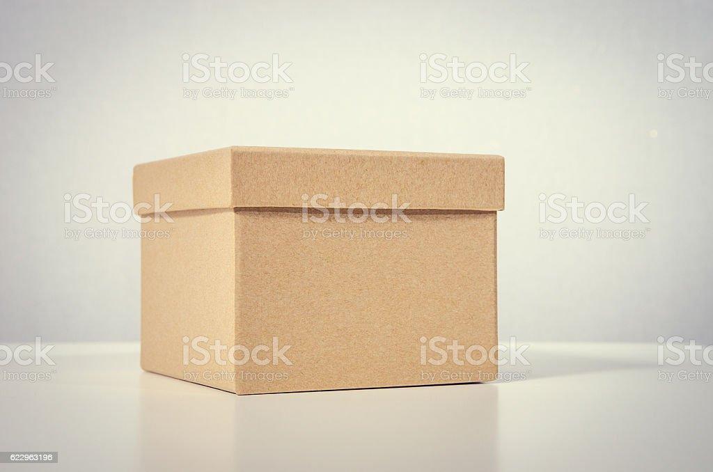 Cardboard box on table stock photo