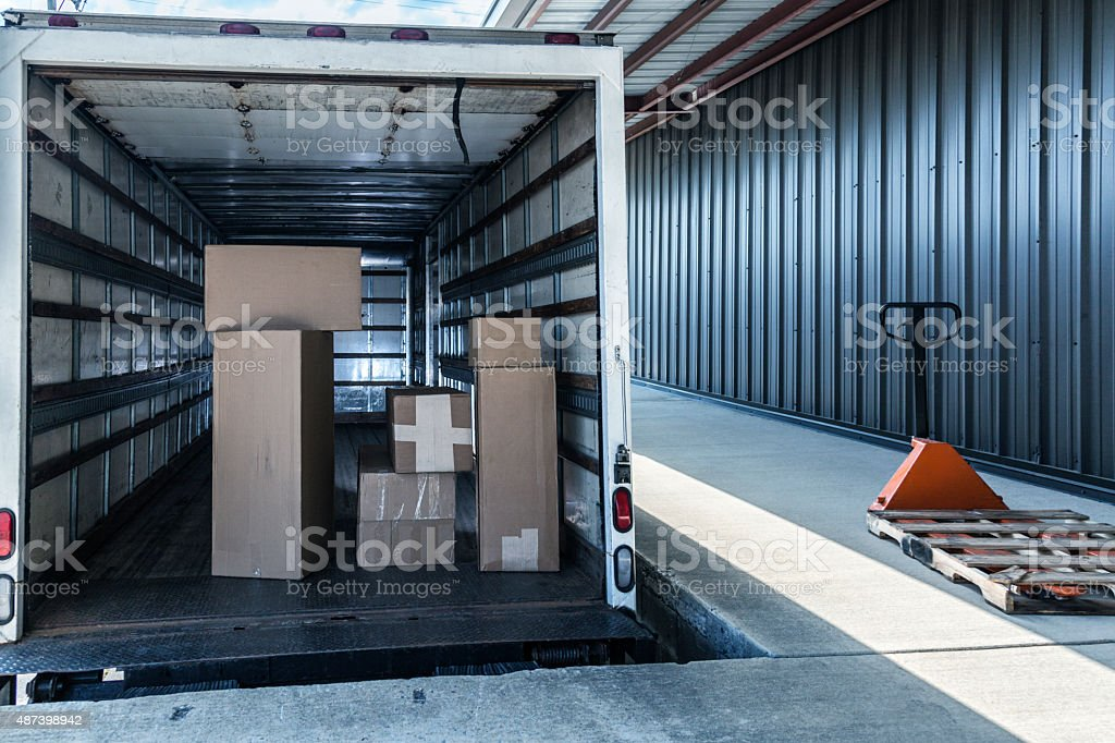 Cardboard Box Retail Merchandise Stacked In Open Delivery Truck stock photo