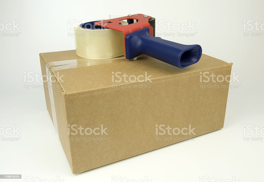 Cardboard Box with a tape dispenser royalty-free stock photo