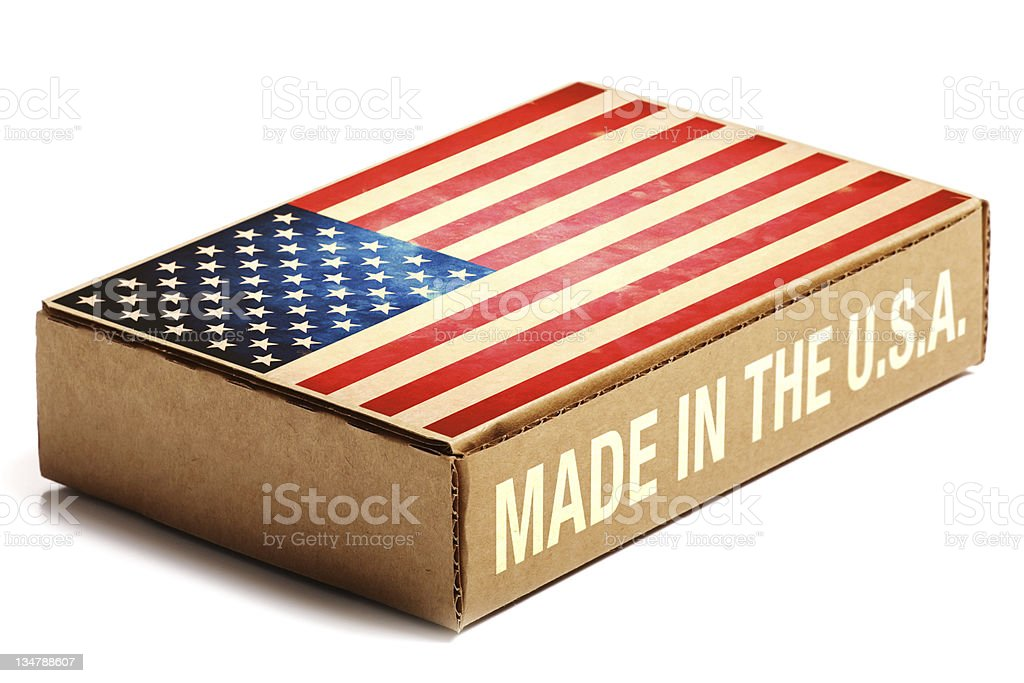 Cardboard box with American flag that says Made in the USA stock photo