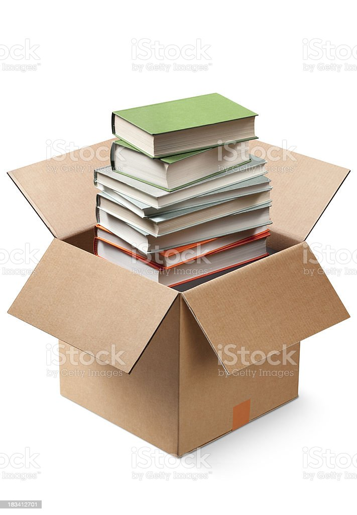 Cardboard box with books stock photo