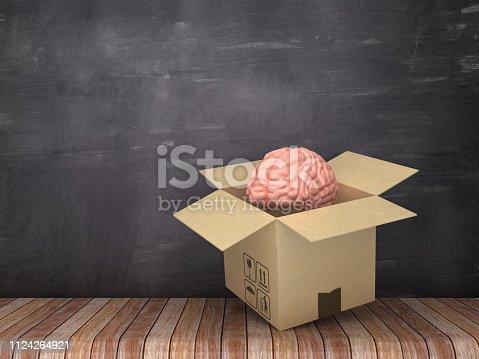 istock Cardboard Box with Brain on Wood Floor - Chalkboard Background - 3D Rendering 1124264921