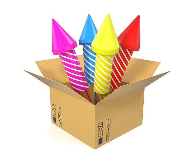 cardboard box with festive rockets inside isolated on white background. - petard stock photos and pictures