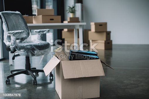 istock cardboard box with folders and office supplies in floor during relocation 1008847976